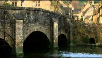 Royalty Free Stock Footage of Old stone bridge in a village in England.