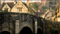 Royalty Free Stock Footage of Pan of an old stone village and a bridge in England.