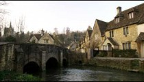Royalty Free Stock Footage of Pan of a bridge in an old stone village in England.