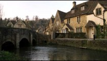 Royalty Free Stock Footage of Bridge over a stream in an old village in England.