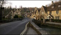 Royalty Free Stock Footage of Motorcycle driving by in an old village in England.
