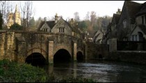 Royalty Free Stock Footage of Bridge over a stream in an old stone village in England.
