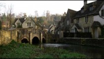 Royalty Free Stock Footage of Clip of a bridge over a stream in an old village in England.
