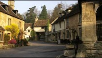 Pan of old stone buildings in a village in England.