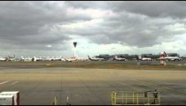 Airport and tarmac with storm clouds in the sky of England.