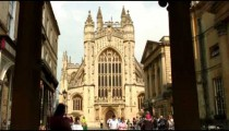 Bath Abbey seen between two pillars in England.