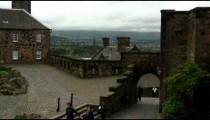 People walking around the Edinburgh Castle in Scotland.