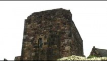 Shot of an old square stone tower in Edinburgh Scotland.