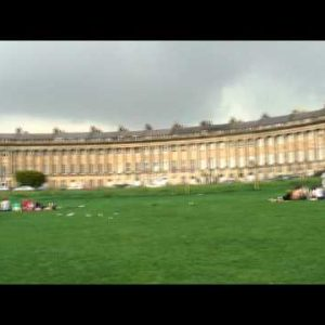 People in front of the Royal Crescent in Bath England.