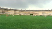 Royal Crescent and people on the lawn in Bath England.