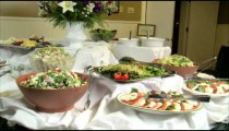 Table full of delicious looking salads and appetizers.