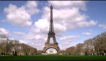 Eiffel tower with clouds in the background.