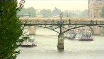 Ferries going under bridges on the Seine River in Paris.