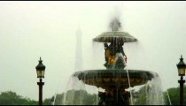 Shot of a fountain with a silhouetted Eiffel Tower in the background.