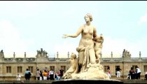 Statue surrounded by people in Versailles.