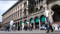 Royalty Free Stock Footage of People walking outside a mall in Milan Italy.