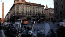 Royalty Free Stock Footage of Busy city street with a row of motorcycle in Bologna Italy.