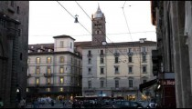 Royalty Free Stock Footage of Busy city street near a plaza in Bologna Italy.