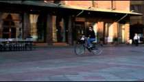 Royalty Free Stock Footage of Man riding a bicycle in a plaza in Bologna Italy.