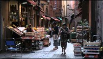 Royalty Free Stock Footage of Panning shot of an alley market in Bologna Italy.