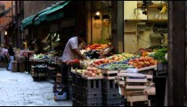 Royalty Free Stock Footage of Man sorting through a market stand in Bologna Italy.