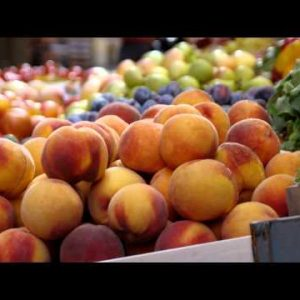 Royalty Free Stock Footage of Man and fruit at a market in an alleyway in Bologna Italy.