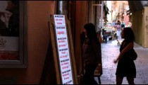 Royalty Free Stock Footage of Two women walking into a shop in Bologna Italy.