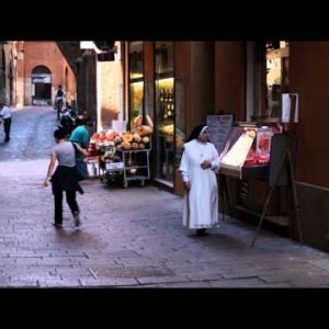 Royalty Free Stock Footage of Nun walking by a street market in Bologna Italy.