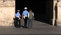 Italian police walking through a plaza in Bologna Italy.