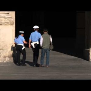 Italian police walking through a plaza in Bologna Italy.