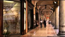 People walking through a mall hall in Bologna Italy.
