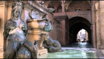 Old fountain with statues in Bologna Italy.