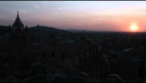 Silhouetted ancient city at sunset.