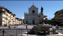 Plaza fountain and ancient building in Italy.