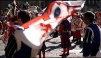 Men dressed in fancy attire in a parade in Italy.