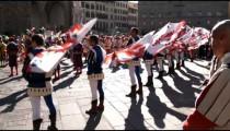 Shot of men in fancy attire in a parade in Italy.