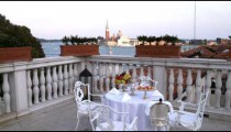 Table and chairs on a deck in Venice.