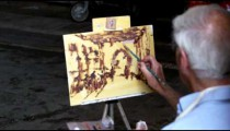 Man painting in Venice Italy.
