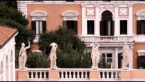 Statues on the roof of a building in Rome Italy.