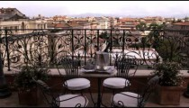 Dolly shot of table and chairs overlooking Rome Italy.