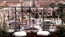 Shot of a table and chairs overlooking Rome Italy.