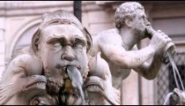 Stone statues in a fountain in Rome Italy.