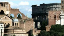 Ancient ruins with the Coliseum in the background in Rome.