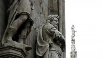 Statues next to a building in Milan Italy.