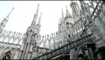 Cathedral and tall elaborate spires in Milan Italy.