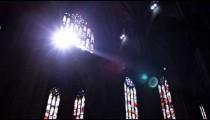 Sun shining through windows of a church in Milan Italy.