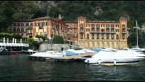 Hotel on Lake Como near a docking area in Italy.