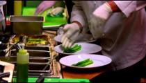 Chefs preparing food at a nice restaurant in Salt Lake City.
