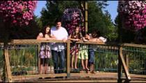 Family on a bridge in beautiful gardens.
