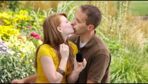 Man proposes to a woman in a beautiful garden.